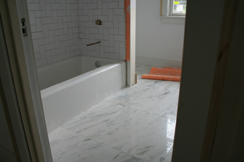 spillane began installing marble flooring in both upstairs bathrooms